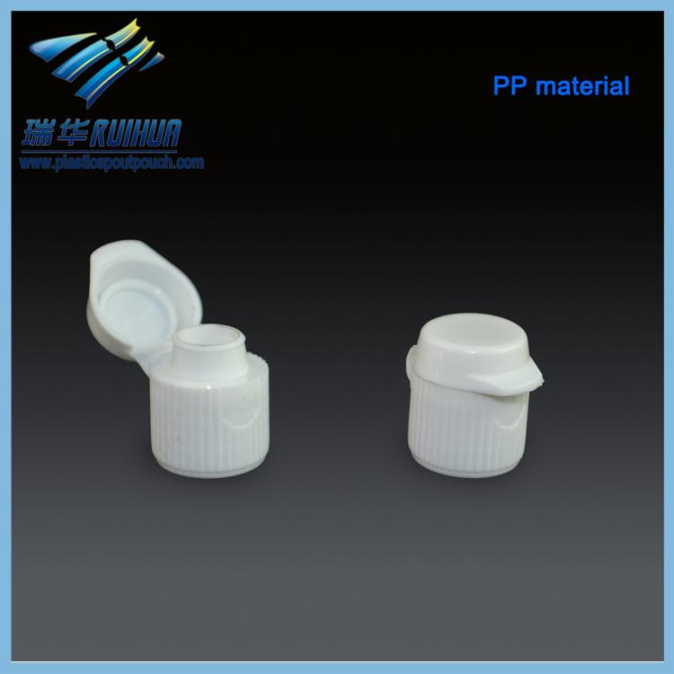 Small white plastic toothpaste flip top caps
